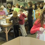 Two organizations donate time to assemble kits for mothers, newborns