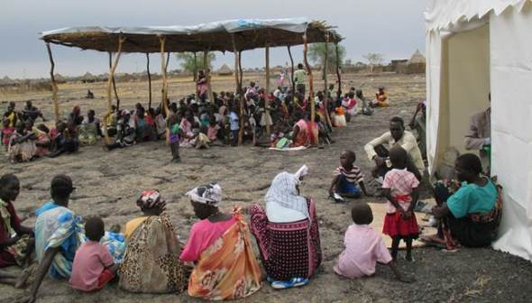 Patients line up to be seen at IMA's relief clinic in Kodok, Upper Nile State, South Sudan. IMA World Health/Bill Clemmer