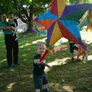 Children enjoyed beating up the pinata -- and then eating the treats from inside.