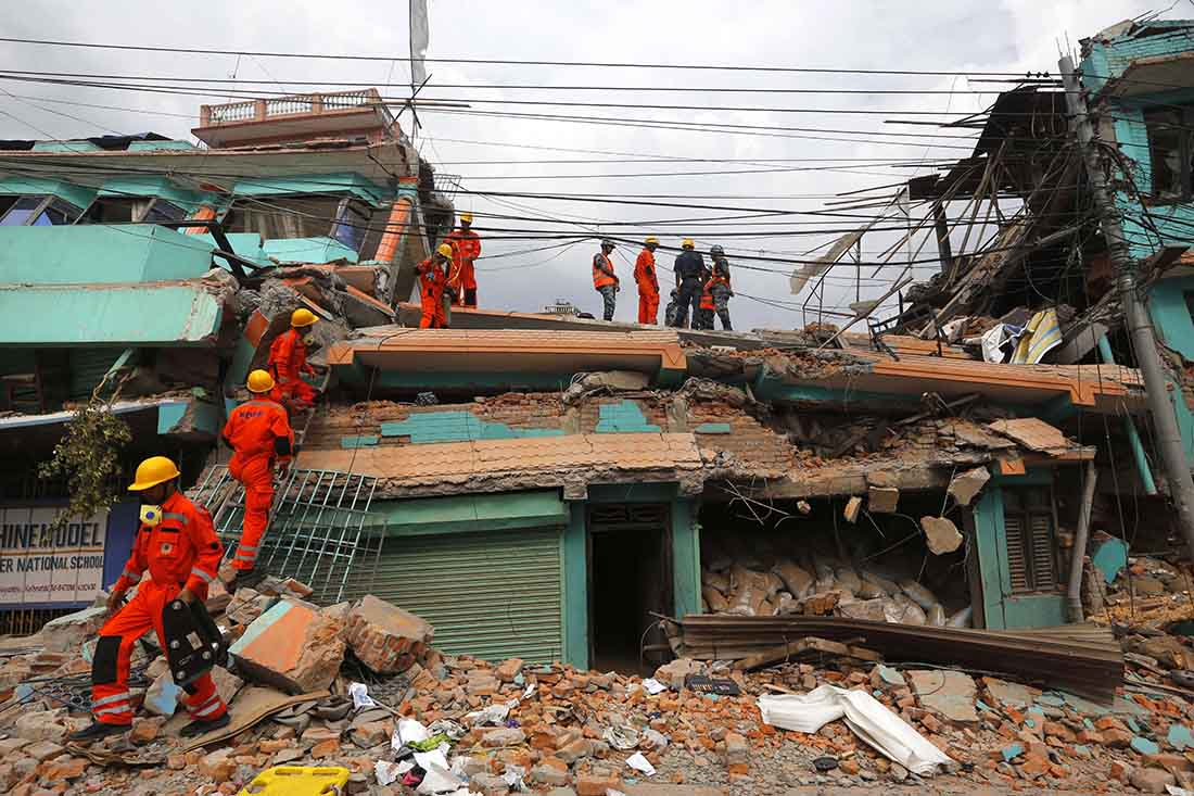 Help Us Raise   Nepal Earthquake Relief  Ima World Health Indias National Disaster Response Force Personnel Look For Survivors In A  Building In Kathmandu