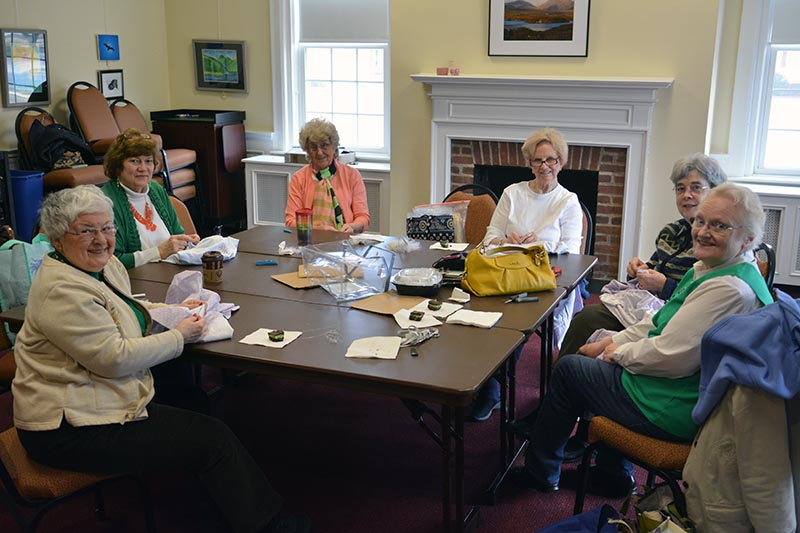 The Catonsville Presbyterian Church's sewing group takes a break to smile for the camera