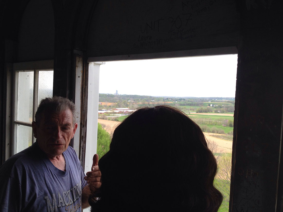 Tom Druck opened the window so everyone could get a better look at the view from the Old Main cupola.