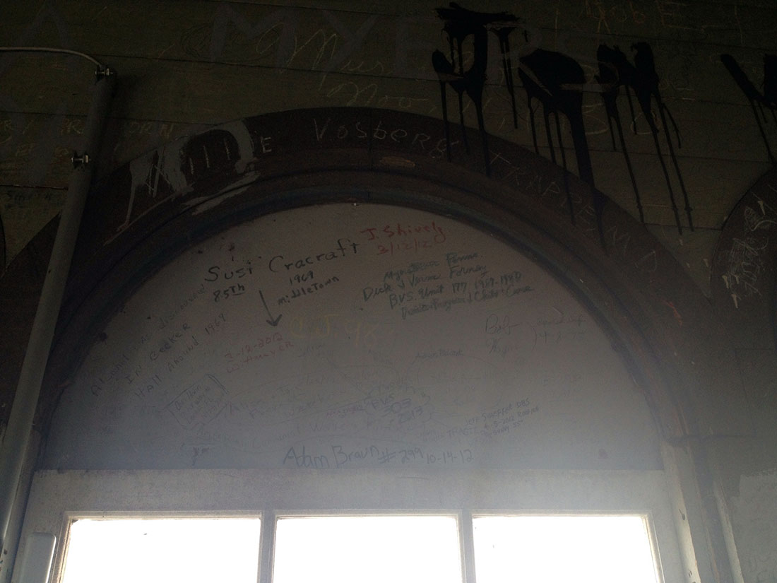More signatures can be seen above a window in the Old Main cupola.