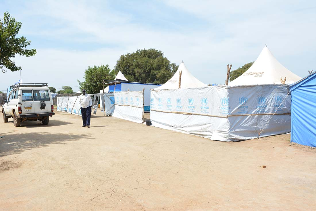 The Bor State Hospital Reproductive Health Outreach Clinic in Mingkaman, South Sudan, is made up of several white tents. Each one has a cement floor so it can be easily washed and swept clean. (IMA World Health/Christopher Glass)