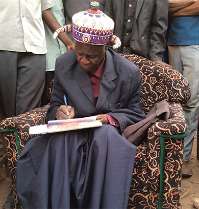 Chief Kibulungu writing a letter
