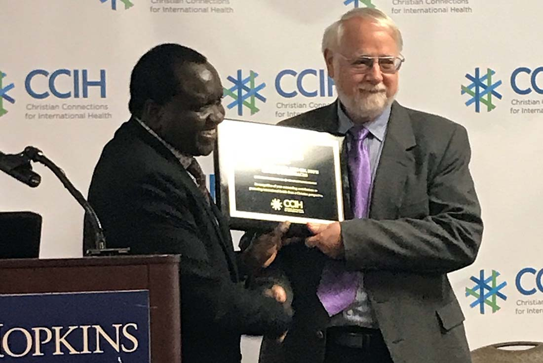 Franklin Baer, a senior advisor to IMA World Health and vice president of SANRU NGO, received the 2017 CCIH Christian International Health Champion Award. Dr. Samuel Mwenda, the 2016 Champion and a former IMA board member, presented Baer with the award Saturday, the final day of the CCIH 2017 conference at Johns Hopkins University.