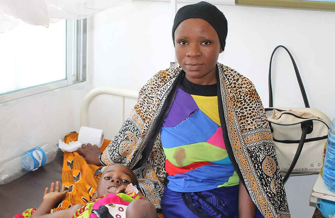 Mwema Hamisi took her daughter, Asha, to three different hospitals before reaching Muhimbili National Hospital. Doctors diagnosed Asha with Burkitt's Lymphoma, an aggressive childhood cancer, and were able to start treatment right away. (Jennifer Bentzel/IMA World Health)
