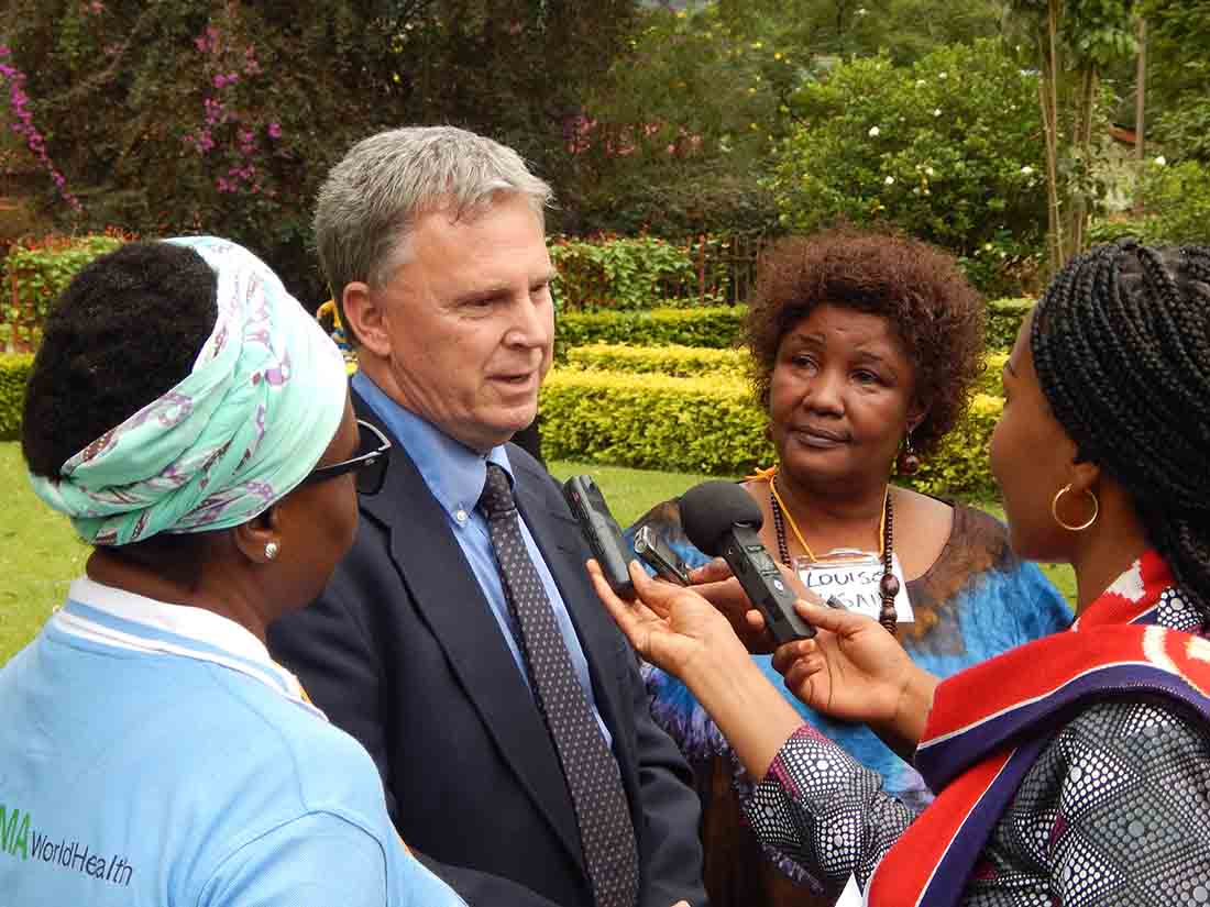 IMA World Health Chief of Party Dr. William Clemmer, center, makes comments during the event in Bukavu.