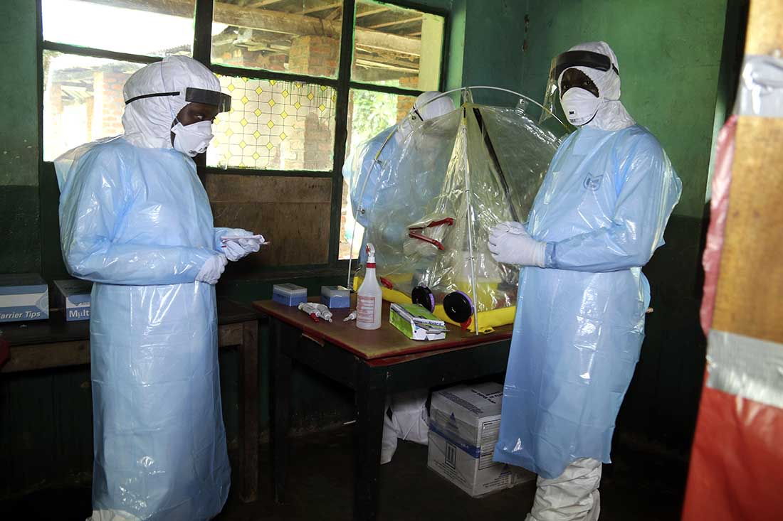 In this photo taken on Sunday, May 13, 2018, health care workers wear virus protective gear at a treatment center in Bikoro Democratic Republic of Congo. Congo's latest Ebola outbreak has spread to a city of more than 1 million people, a worrying shift as the deadly virus risks traveling more easily in densely populated areas. Two suspected cases of hemorrhagic fever were reported in the Wangata health zones that include Mbandaka, the capital of northwestern Equateur province. IMA World Health is responding by raising funds to position more health care workers in DRC and to purchase additional PPEs for anyone responding to the outbreak. (AP Photo/John Bompengo)
