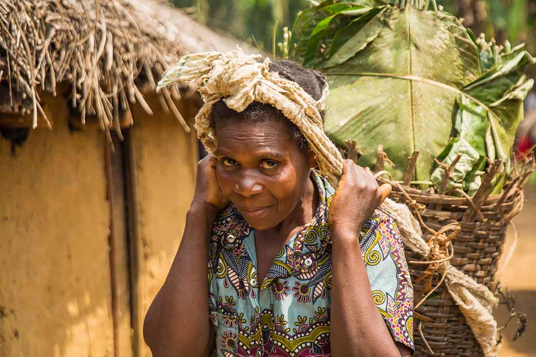A survivor spends her days foraging in the forest for bananas, which she sells at the market. (Photo by Crystal Stafford/IMA World Health)