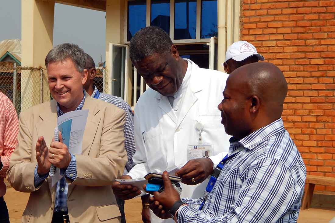 Dr. Denis Mukwege and Dr. Bill Clemmer celebrate during an event at Panzi Hospital in 2017. (IMA World Health photo)