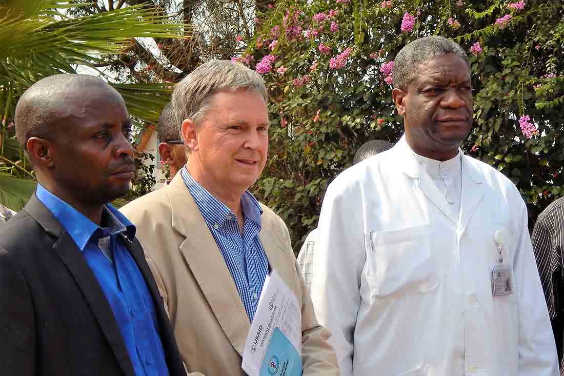 Dr. Denis Mukwege is pictured at Panzi Hospital in 2017 when the United States Agency for International Development extended the Ushindi Project award and IMA provided a new subagreement, as well as a vehicle and motorcycles, to Dr. Mukwege and his team. He is pictured with Pascal Musaraza, Panzi Program Manager for the USAID/IMA Ushindi Project, and Dr. Bill Clemmer, IMA Chief of Party for the Ushindi Project. (IMA World Health photo)