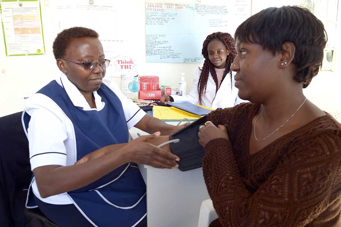Nurse Elizabeth Michire counsels Mary* at a clinic in Mama Lucy Kibaki Hospital in Nairobi. Looking on is Whitney Adhiambo, a 22-year-old student. (Photo by Matt Hackworth/IMA World Health)