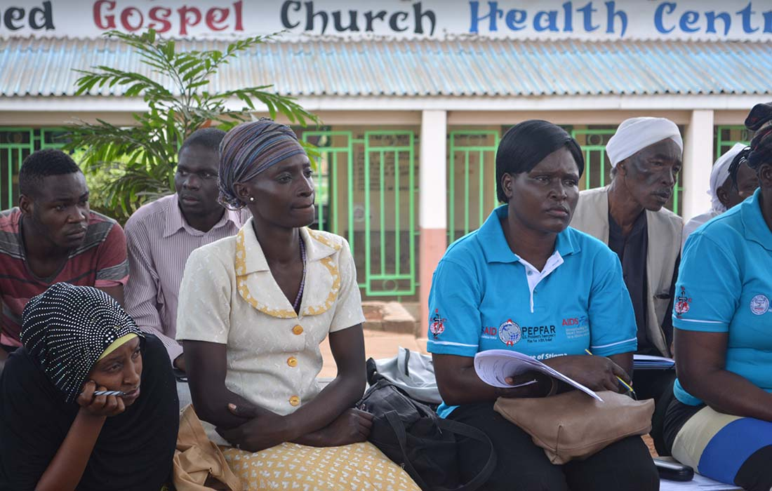 Faith leaders and health workers gather outside of Redeemed Gospel Church Health Centre, a combined facility within an informal settlement outside of Nairobi, Kenya.