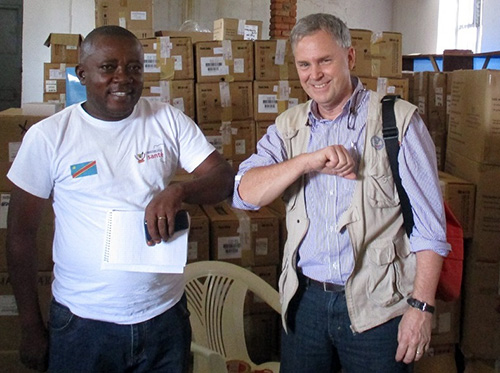 Dr. William Clemmer, right, of IMA World Health and Lutheran World Relief, demonstrates the elbow bump greeting with a colleague.